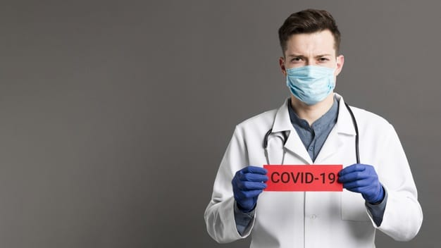 Doctor Holding Covid 19 Card